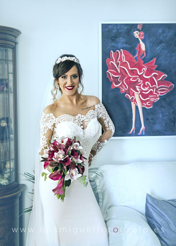 Fotografía de boda con vestido de novia